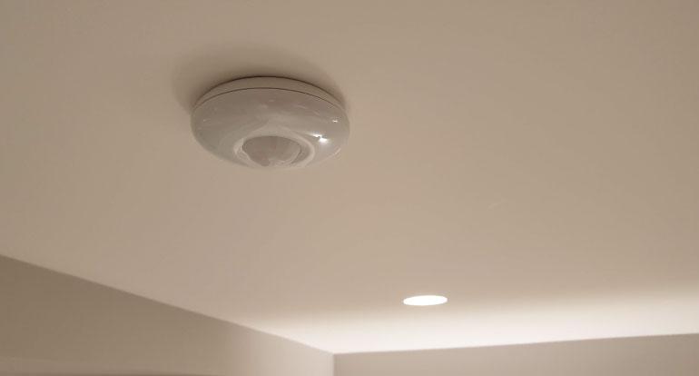 burglar alarm sensor installed on the ceiling in london