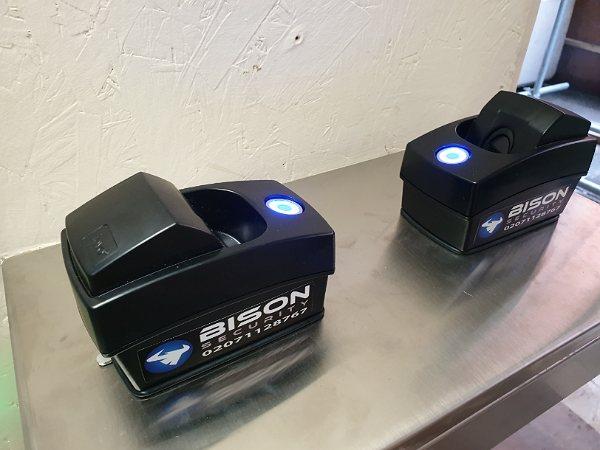 2 biometric readers installed on half height turnstile near site security office