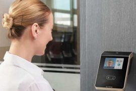 non-contact facial biometric reader installed on the wall near entrance